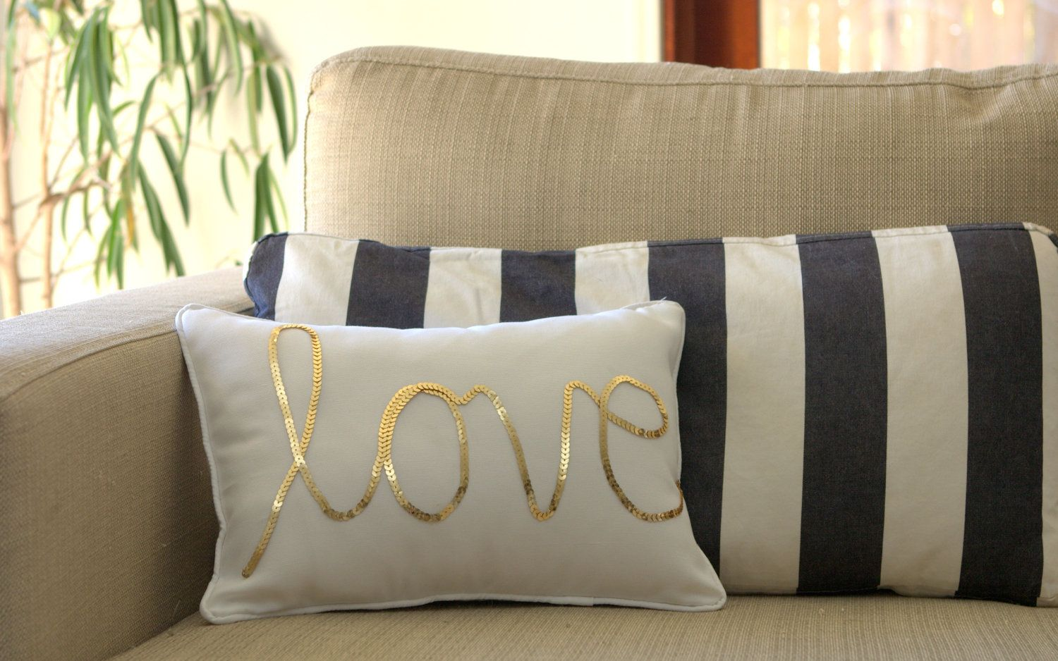 Diydress up a plain throw pillow with some sequins because