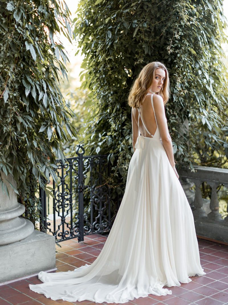 We Re Swooning Over The Criss Cross Back On This Long Flowy Wedding Dress Modern Silk Bridal Gown Iv Wedding Dresses Wedding Dress Flowy Silk Bridal Gown