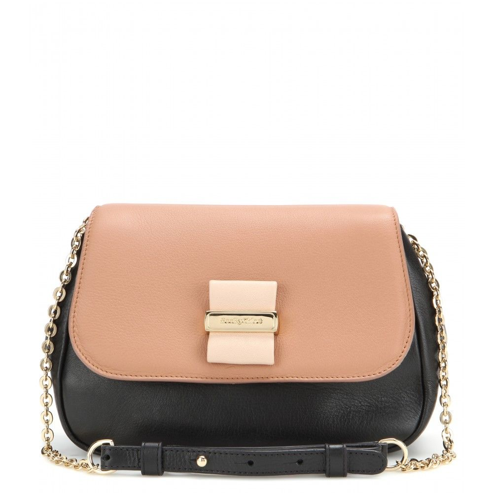 See by Chloé - Rosita leather shoulder bag - The 'Rosita' bag from See By Chloé is crafted from a mix of black and clay hued leather. We love the iconic leather bow and gold-tone embossed plaque on the front. Carry it from day to night with the chain and leather shoulder strap. seen @ www.mytheresa.com