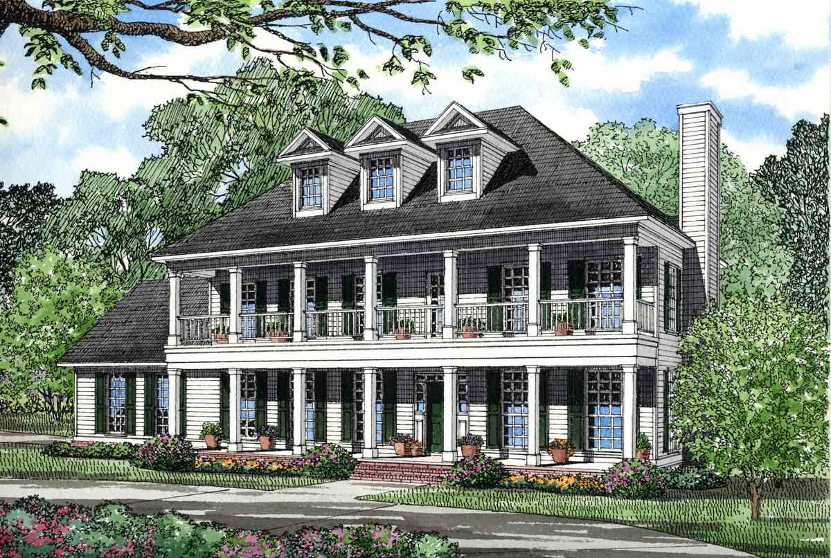 this two story country style home has a second floor balcony above this two story country style home has a second floor balcony above porch at the front all three bedrooms and the gameroom are on the second floor