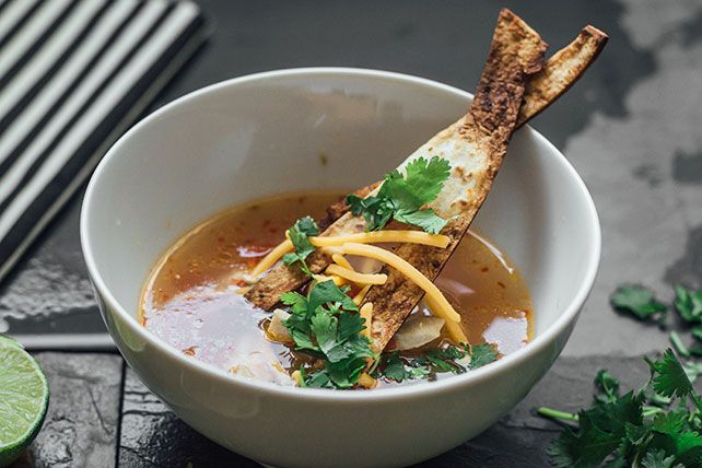 Tortilla strips and shredded cheddar cheese are the finishing touches to this easy-to-make, crowd-pleasing chicken-tortilla soup.
