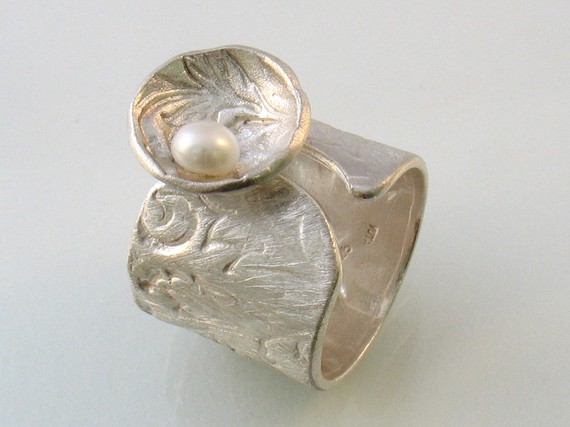 Satin flowers texture on open band silver ring with pearl by yutal, $140.00
