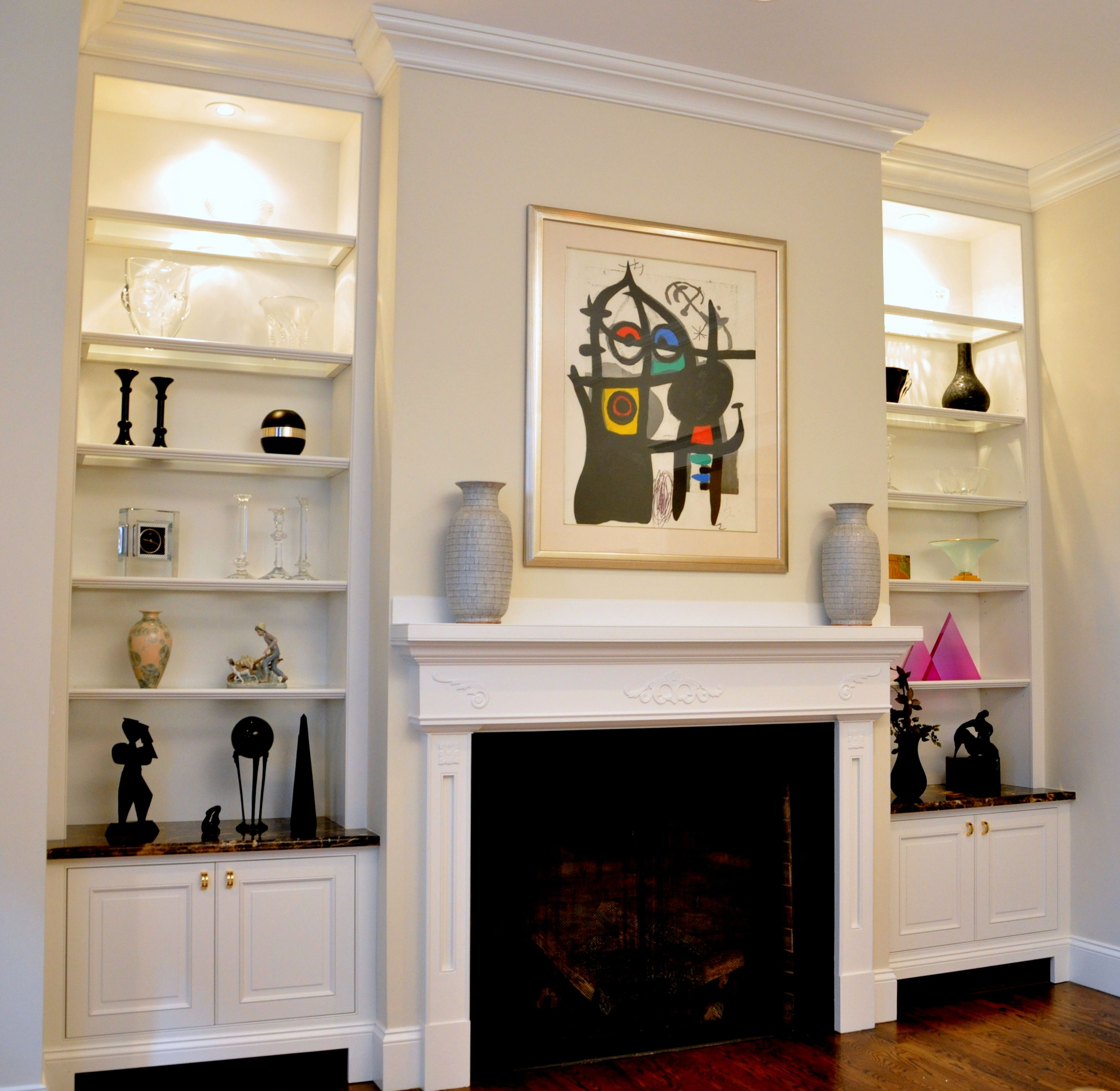 Room These cabinets flanking a fireplace provide