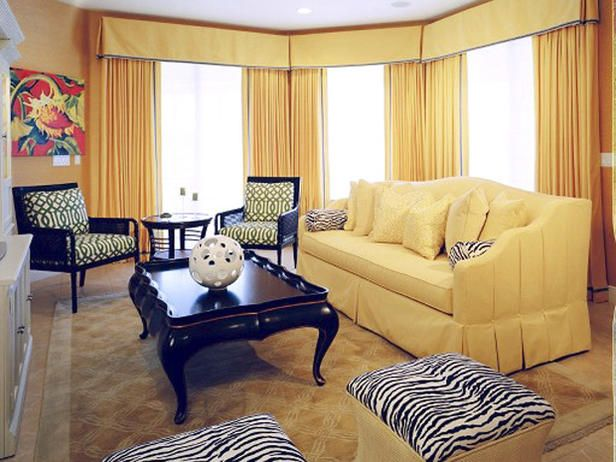 Inspired by '50s Palm Beach style, a sunny mood dominates this Florida living room. The designer built the look around a glamorous citrus color palette with black accents. By using green stylized-print upholstery on faux bamboo chairs and a splash of white to accentuate the zebra print, a cheerful yet sophisticated look was achieved. Photograph by Roy Quesada.