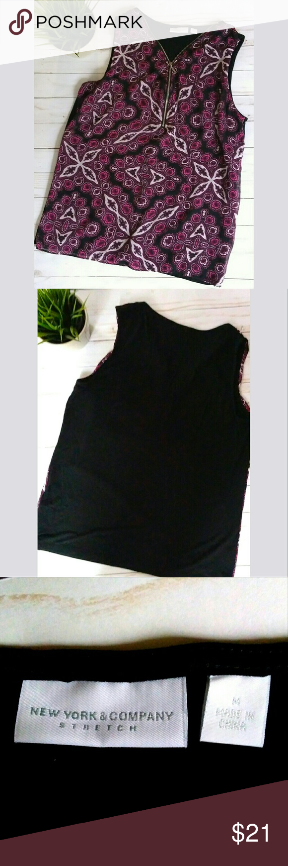 New York & Company sleeveless top with zipper. New York & Company sleeveless top.  It has a zipper on the front down to the bust area.  It has a double layer front. Bottom layer is black and top layer is a black, white and magenta patterned fabric.  It is a very comfy and stretchy top perfect for summer!  Pet free smoke free home. New York & Company Tops