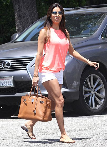 Eva Longoria stepped out in a pastel top in Los Angeles. Love her bag!