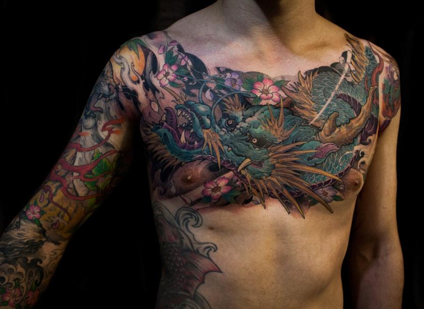 Chronic ink tattoo toronto tattoo full chest dragon for Fake tattoo sleeves toronto