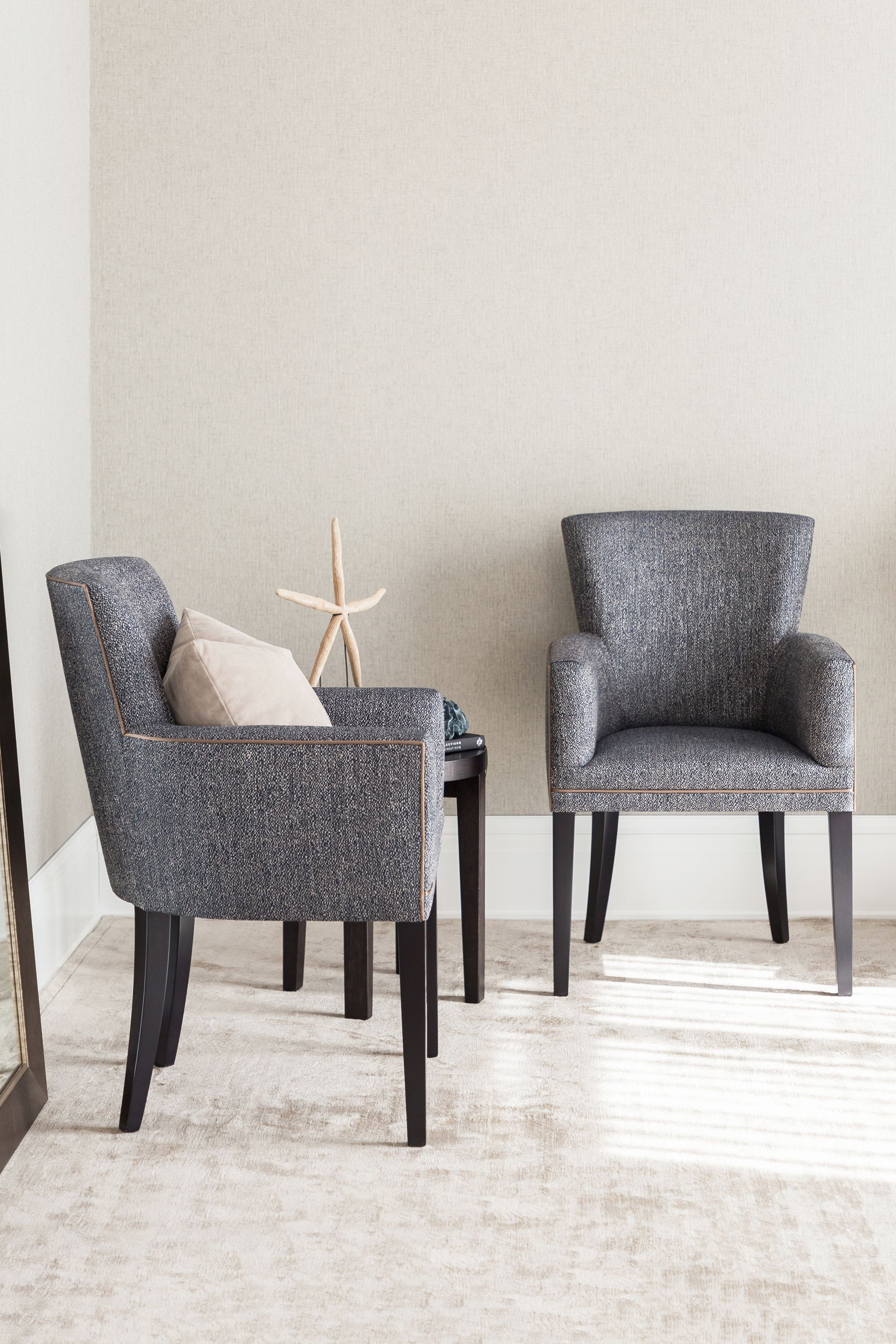 The Laura Carver dining chair is presented with a curved