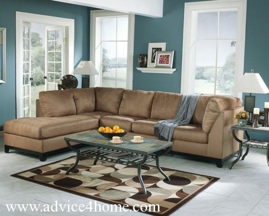 white and dark teal wall and coffee sofa in living room | for the