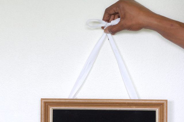 How To Hang A Picture With Ribbon Ehow Hanging Pictures Photo Wall Hanging Picture Frame Hangers