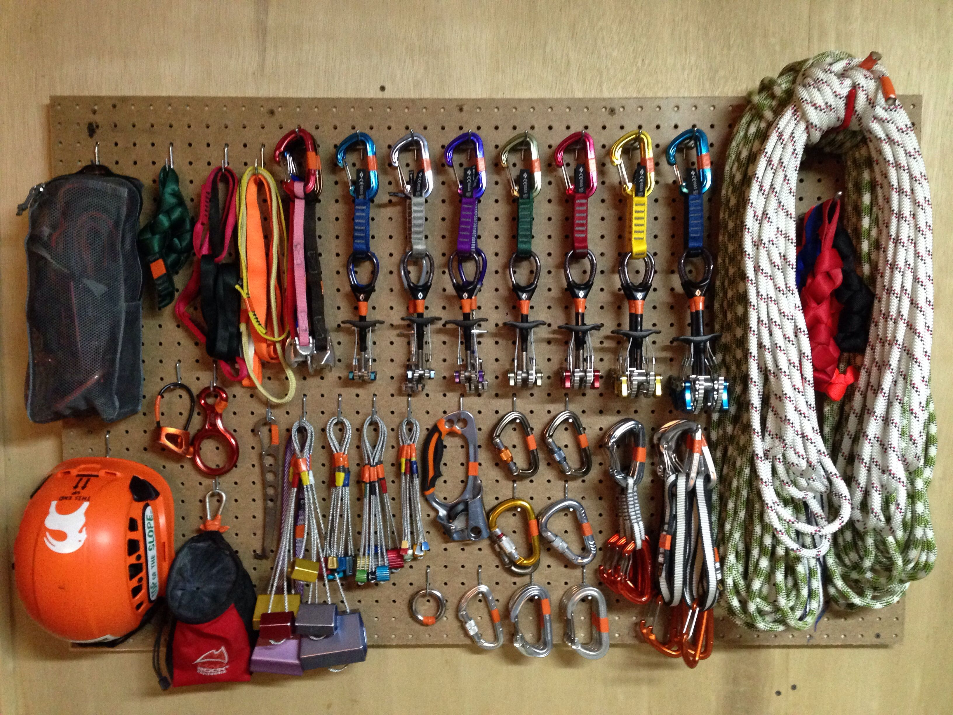 "Rock climbing gear. Pegboard 31""x48"" looks great and keeps ..."