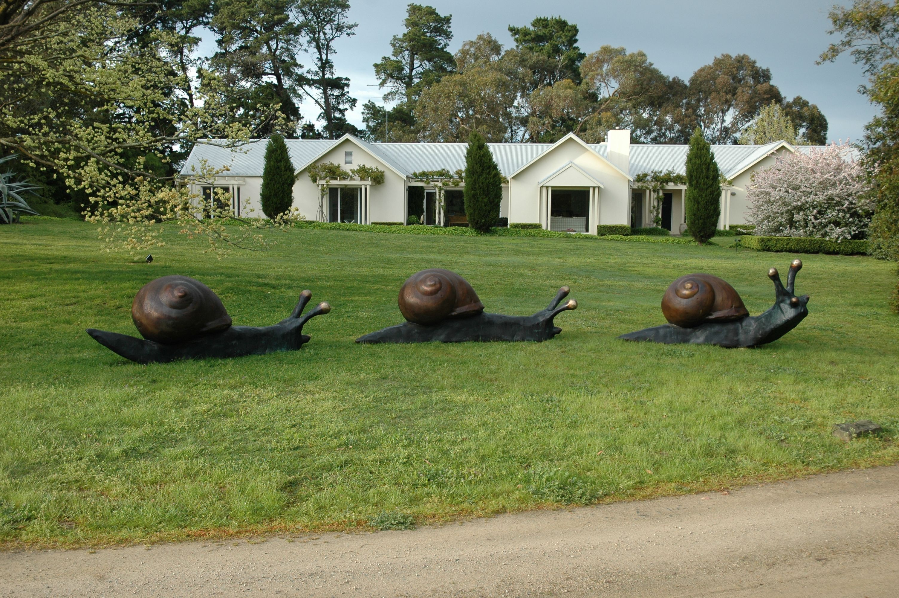 Giant snail trail willie wildlife sculpture sculpture for Lawn ornaments for sale