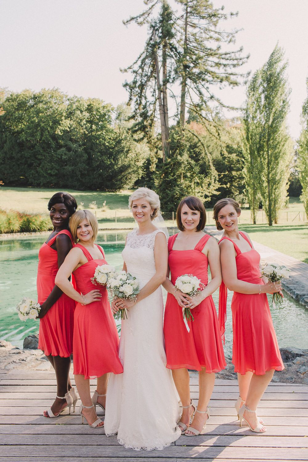 Wedding gown with red accents  A destination wedding in the Dordogne with lace wedding gown and