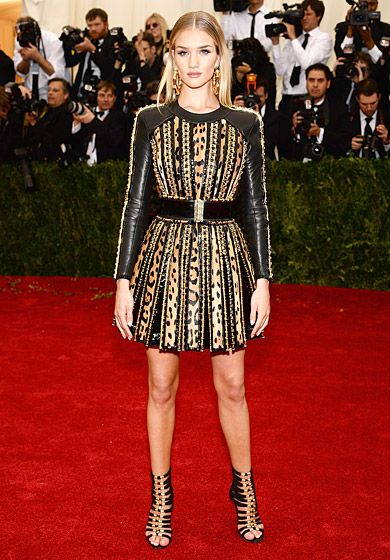 Rosie Huntington-Whiteley is gladiator chic in a short Balmain dress at the 2014 Met Gala