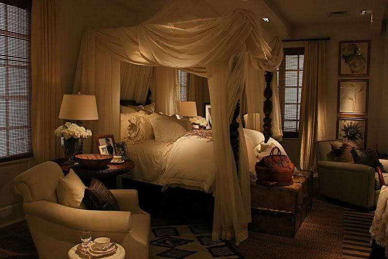 Moody Lighting Around A Canopy Bed
