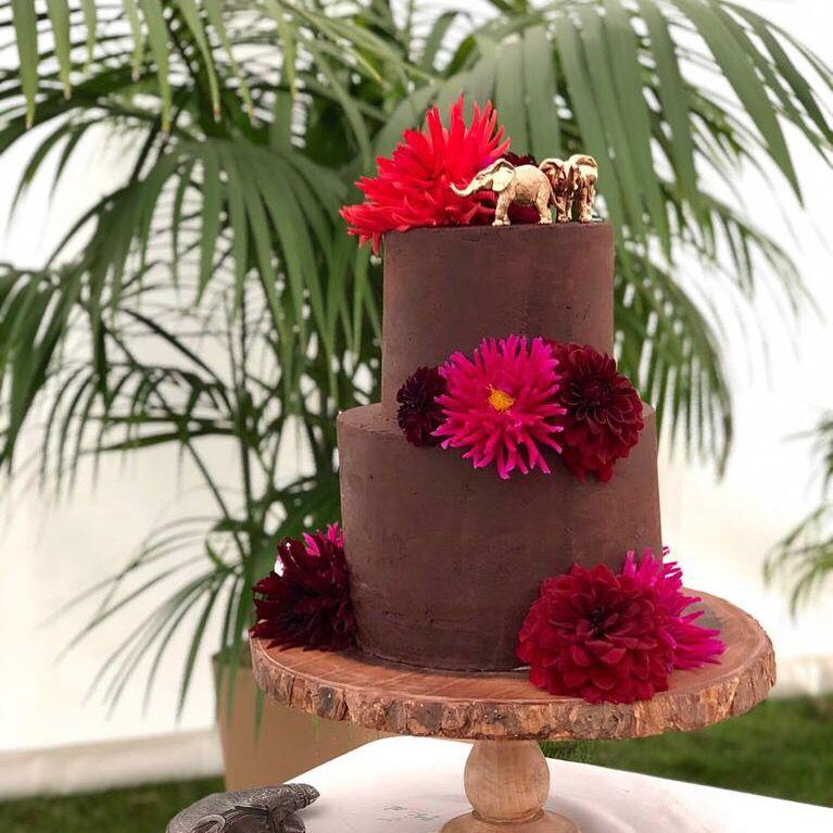 A sri lankan inspired chocolate ganache cake hand