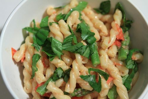 gemelli with asparagus, tomatoes and ricotta, and topped with basil