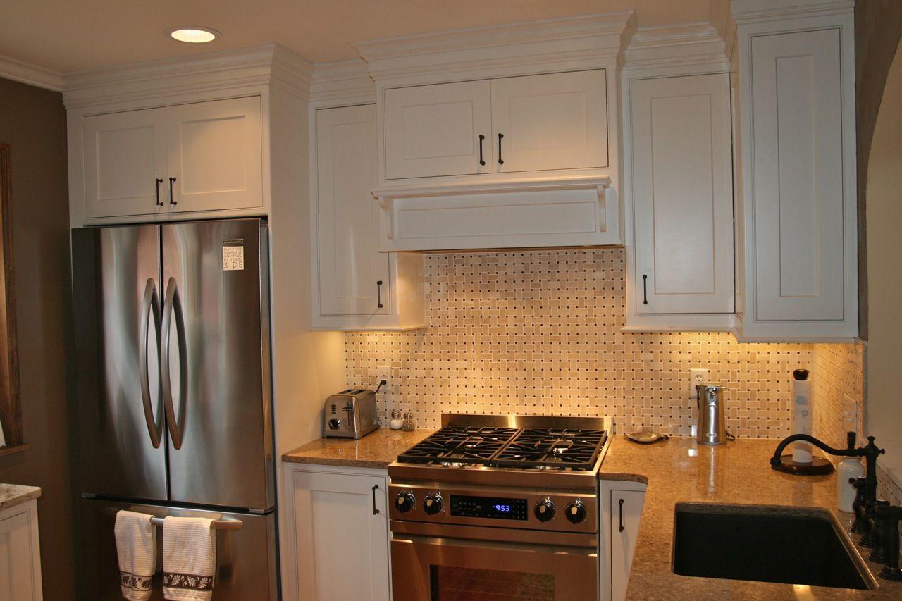 - White Kitchen With Basket Weave Tile Backsplash And Granite