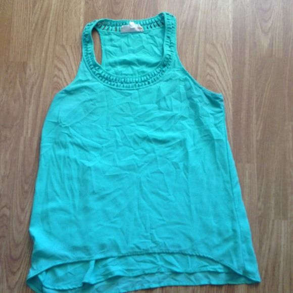 Mint color tank with detail on top Bought this from a fellow posher but it's too small. Has detail on top and has a lining inside of shirt. Mint colored Lost April Tops Tank Tops