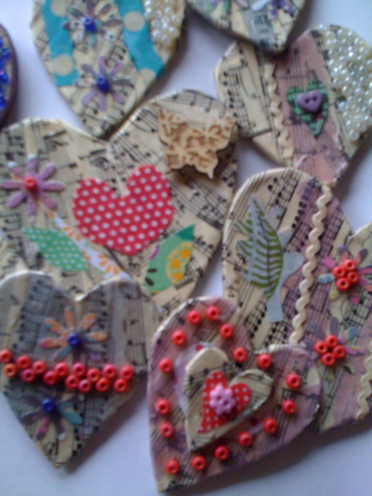 Paper brooches made for valentines. Selling at Millie Moon shop.