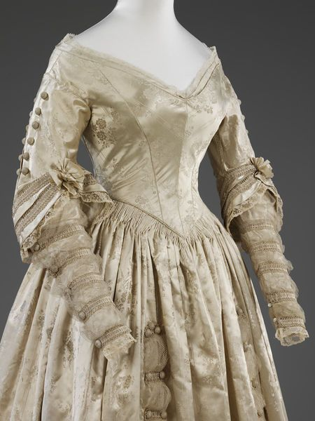 Wedding dress 1841 This was an extremely sophisticated dress for 1841. The low-cut neckline is an especially modish feature which appears in fashion plates of the decade. Many nineteenth century brides wore matching capes or pelerines over low-cut bodices, or covered exposed necks and upper chests with high-necked chemisettes.