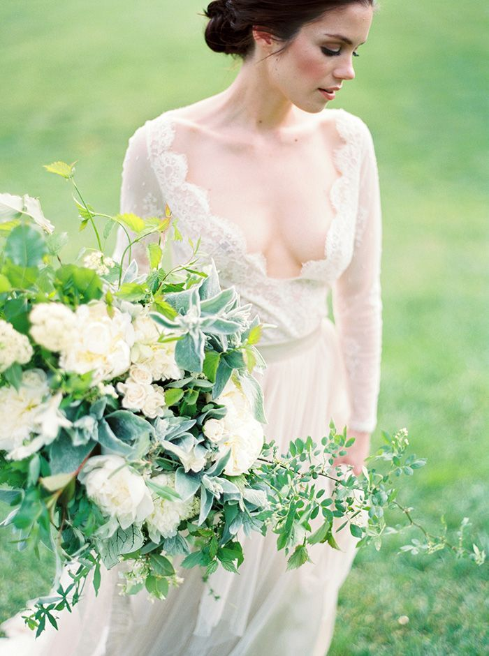 Long Sleeve Lace Wedding Dress With An Organic Greenery Bouquet