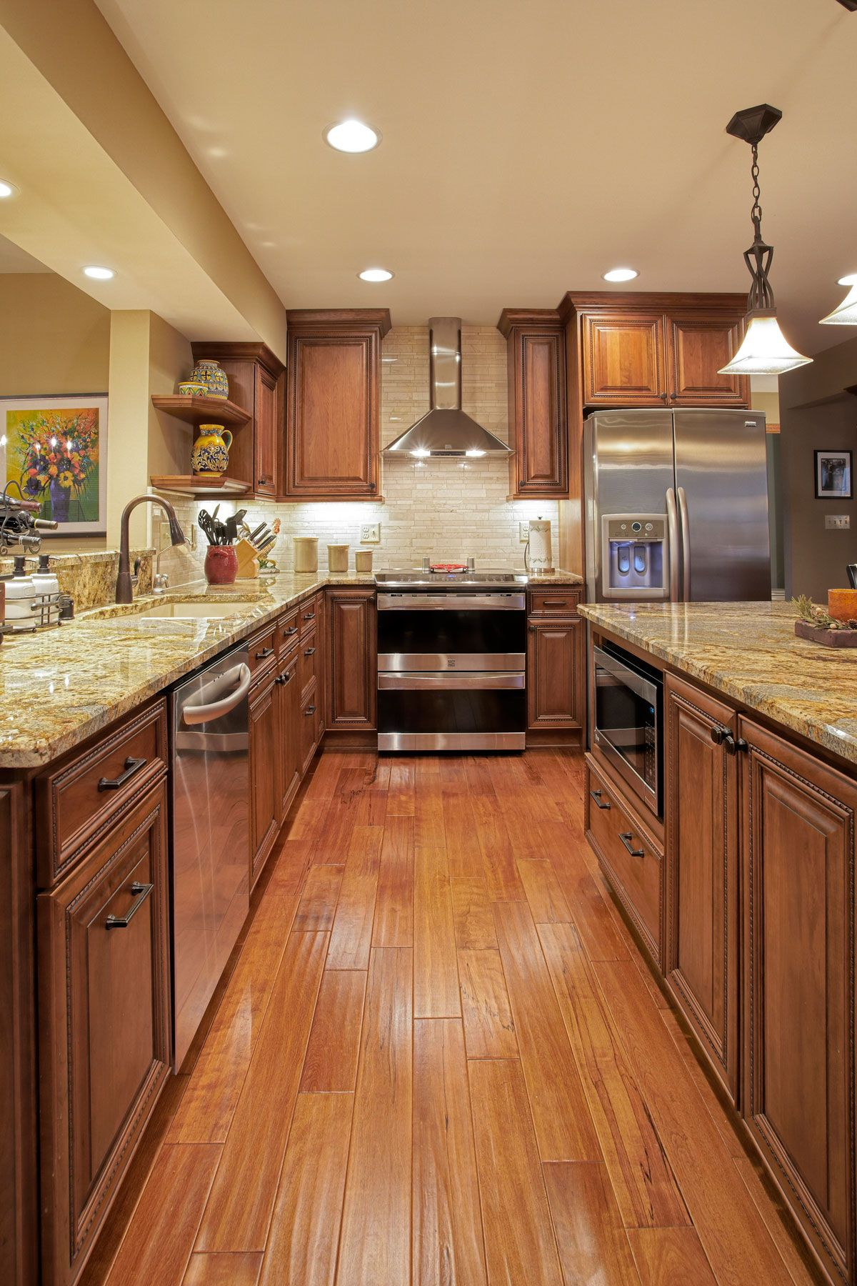 Woods In Warm Rich Medium Brown Tones Were Used To Great Success In This Kitchen Remodel In Brown Kitchen Cabinets Wooden Kitchen Cabinets Kitchen Renovation