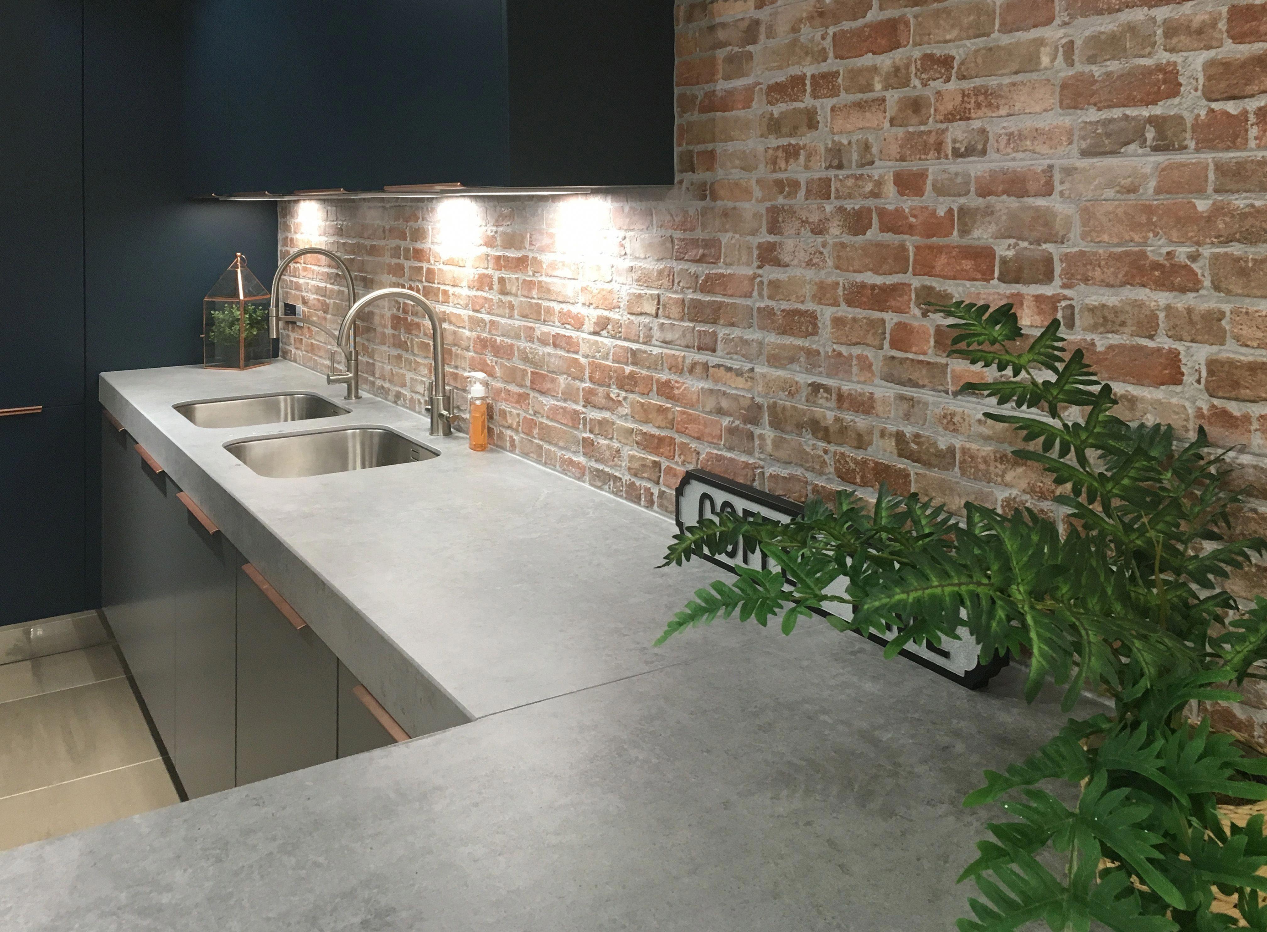 Dark Kitchen And Concrete Worktop With Exposed Brick Walls Kitchenremodelingideasblackappliances In 2020 Exposed Brick Kitchen Brick Kitchen Brick Wall Kitchen