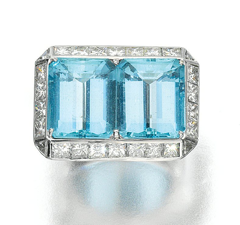 AQUAMARINE AND DIAMOND RING.  Set with two step-cut aquamarines within a border of princess-cut and triangular diamonds