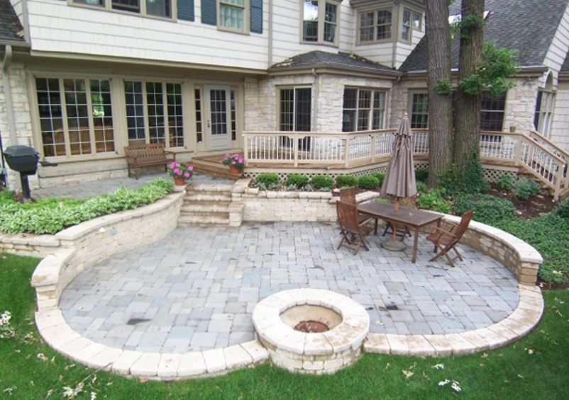 Heart Shaped Stone Patio With Wood Deck Contact Us For A