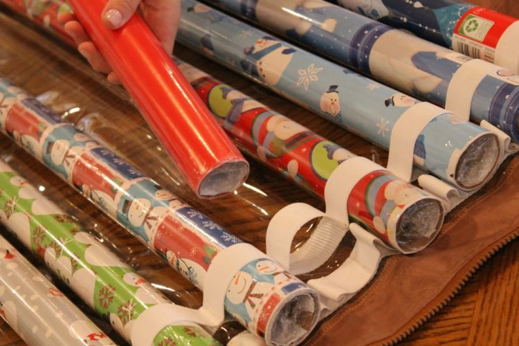 Gift Wrap Storage Ideas   Wrap IT   Slide Wrapping Paper Roll Into Elastic  Step 1
