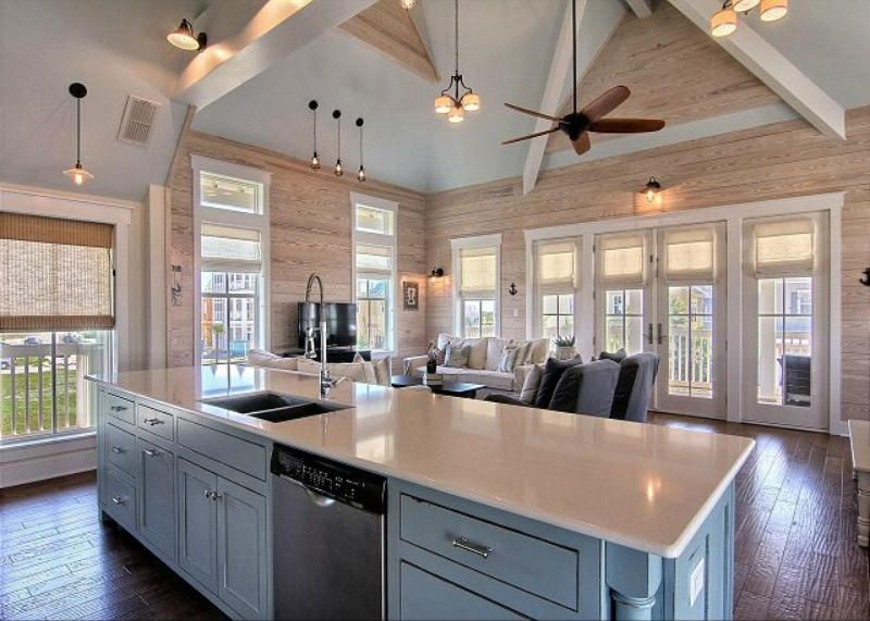 Rustic great room with ceiling fan cathedral ceiling for Kitchen and great room designs