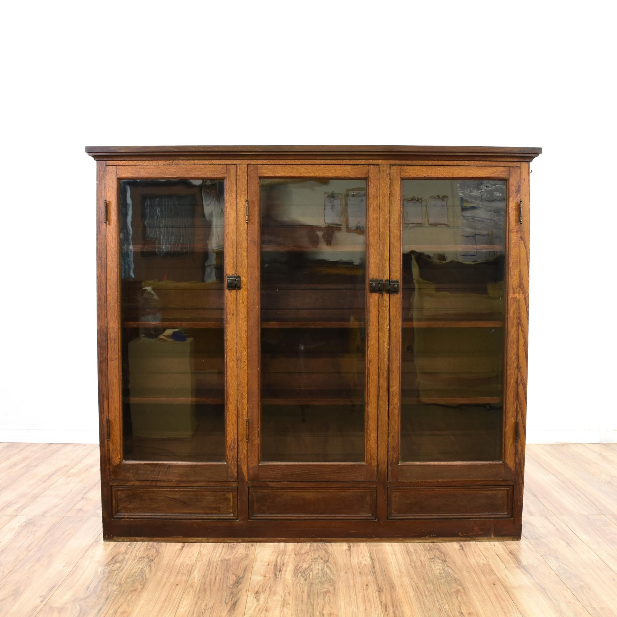 This Display Cabinet Is Featured In A Solid Wood With A Distressed