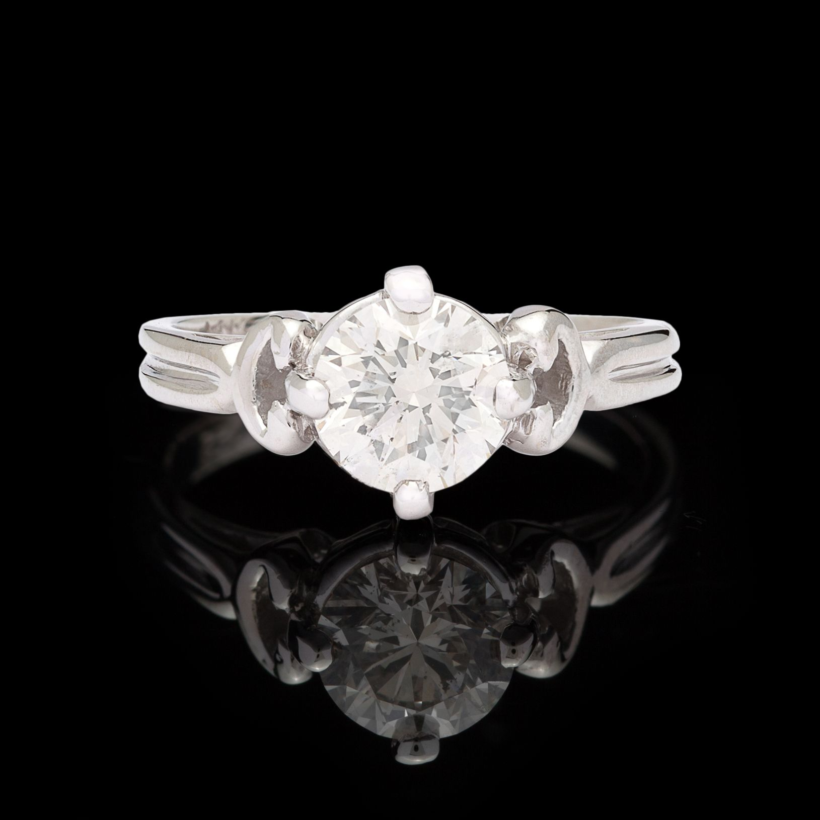 Unique 14Kt White Gold Solitaire Engagement Ring Features a 1.09 Carat I SI Quality Round Brilliant Cut Diamond.  The ring is currently a 5.0 and can be resized up or down.  This piece totals 3.6 grams.