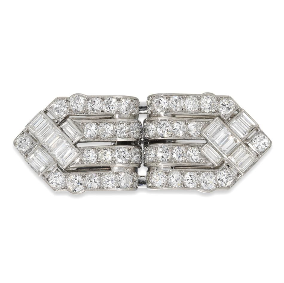 A Cartier Art Deco diamond double clip brooch A fine Cartier Art Deco diamond double clip brooch, the geometrically-designed brooch set throughout with brilliant-cut and baguette-cut diamonds, estimated to weight a total of 3.65 carats, all set to a platinum mount with detachable brooch fittings, signed Cartier, circa 1920, gross weight 11.4 grams