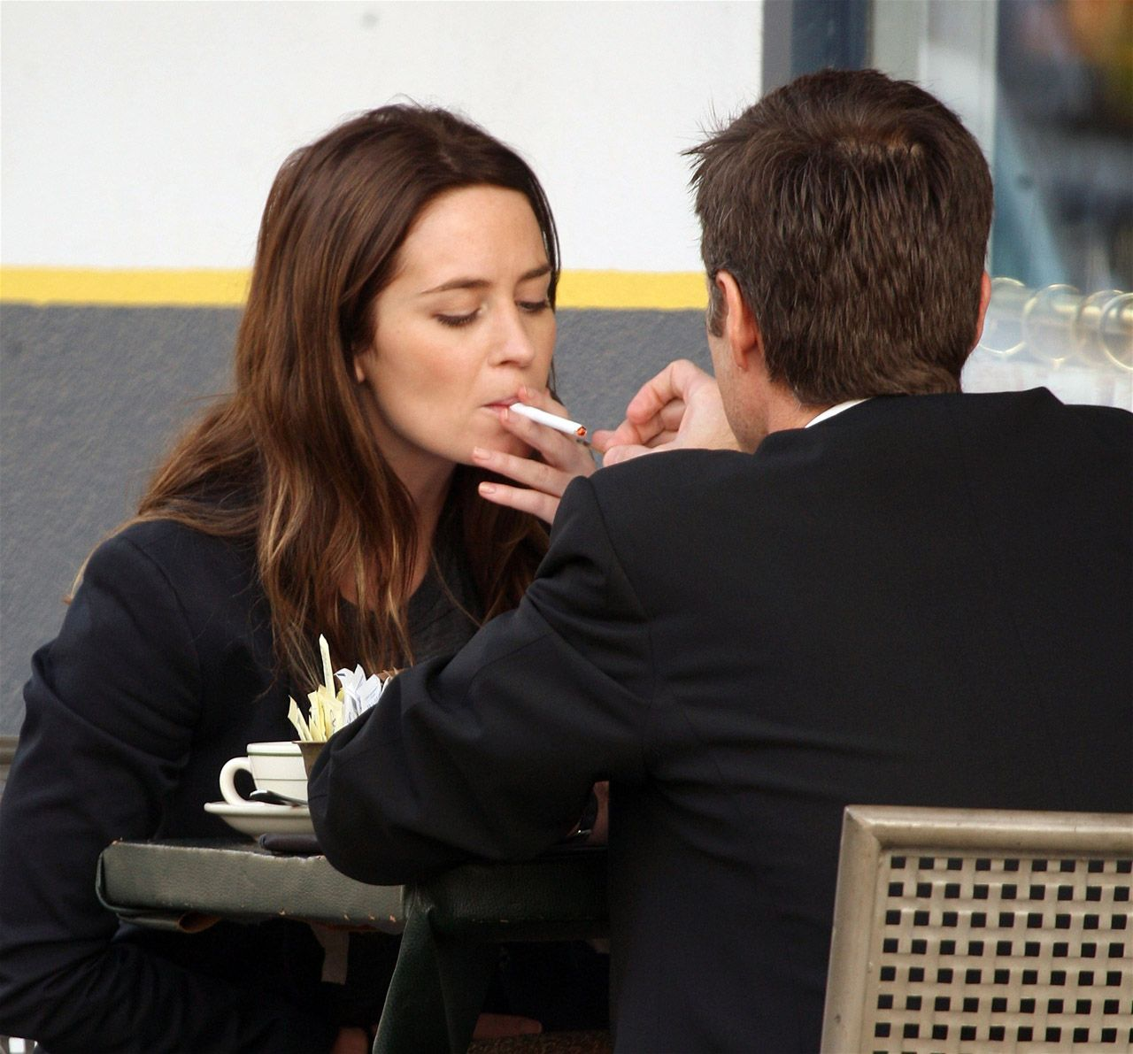 Emily Blunt smoking a cigarette (or weed)