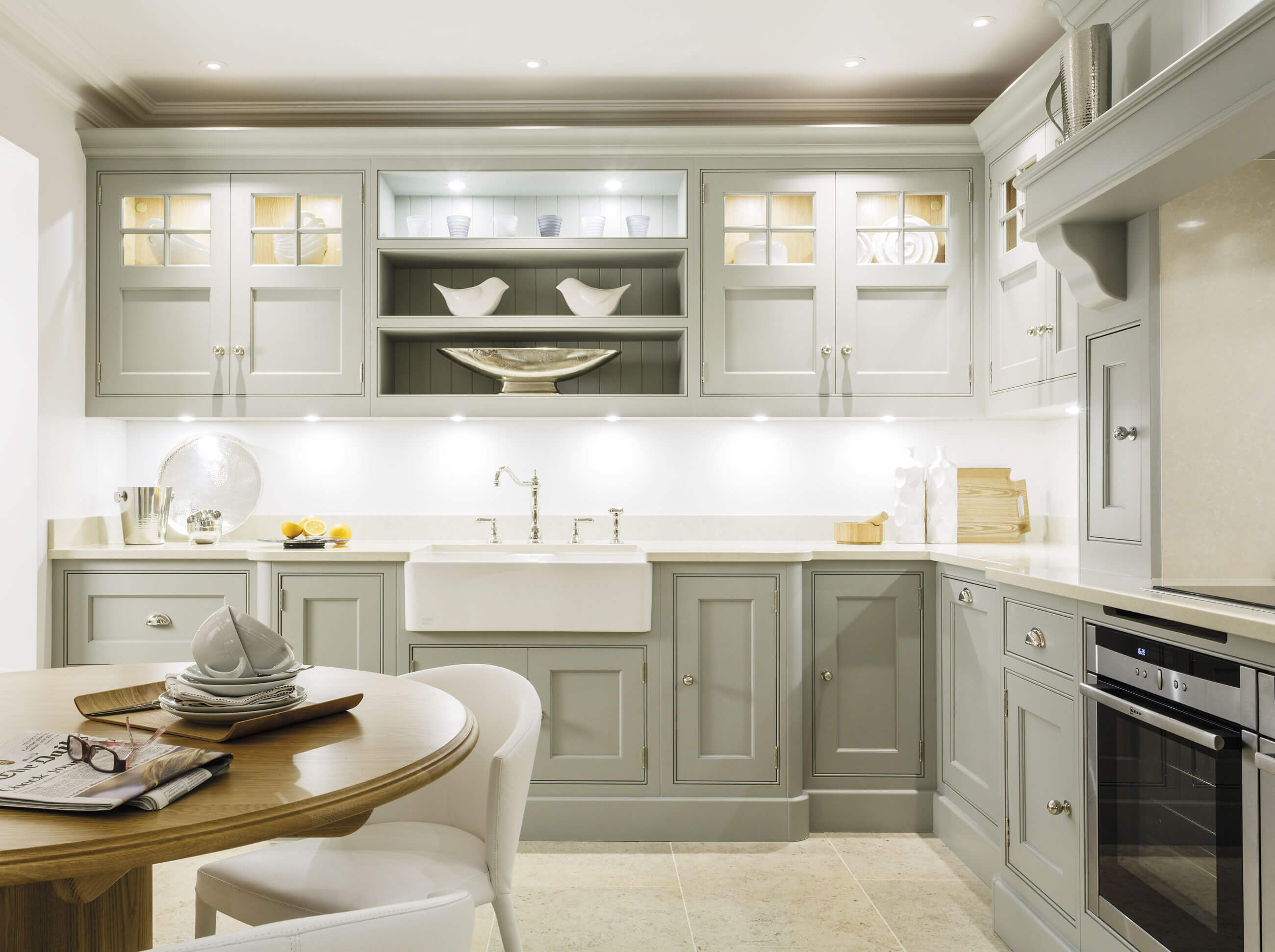 This exquisite chicory painted kitchen features stunning glass ...