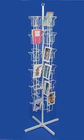 48 pocket rotating greeting card rack 3 our painted nest 3 greeting card rack used to hold lots of family pictures for anyone to pick up and look through most likely in the den m4hsunfo