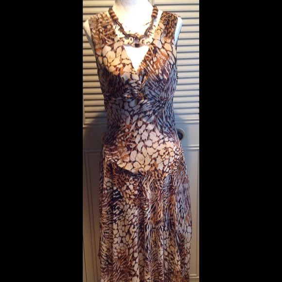 "Super cute Dress Barn Leopard Print Dress This dress is adorable on! Leopard print in earth tones, uneven drop waist with uneven hem, falls into midi/ ankle length. Polyester dark brown lined with sheer nylon overlay. Sleeveless, size 8 , shoulder to longest length is 46"" . The necklace is a perfect compliment! Dress Barn Dresses Midi"