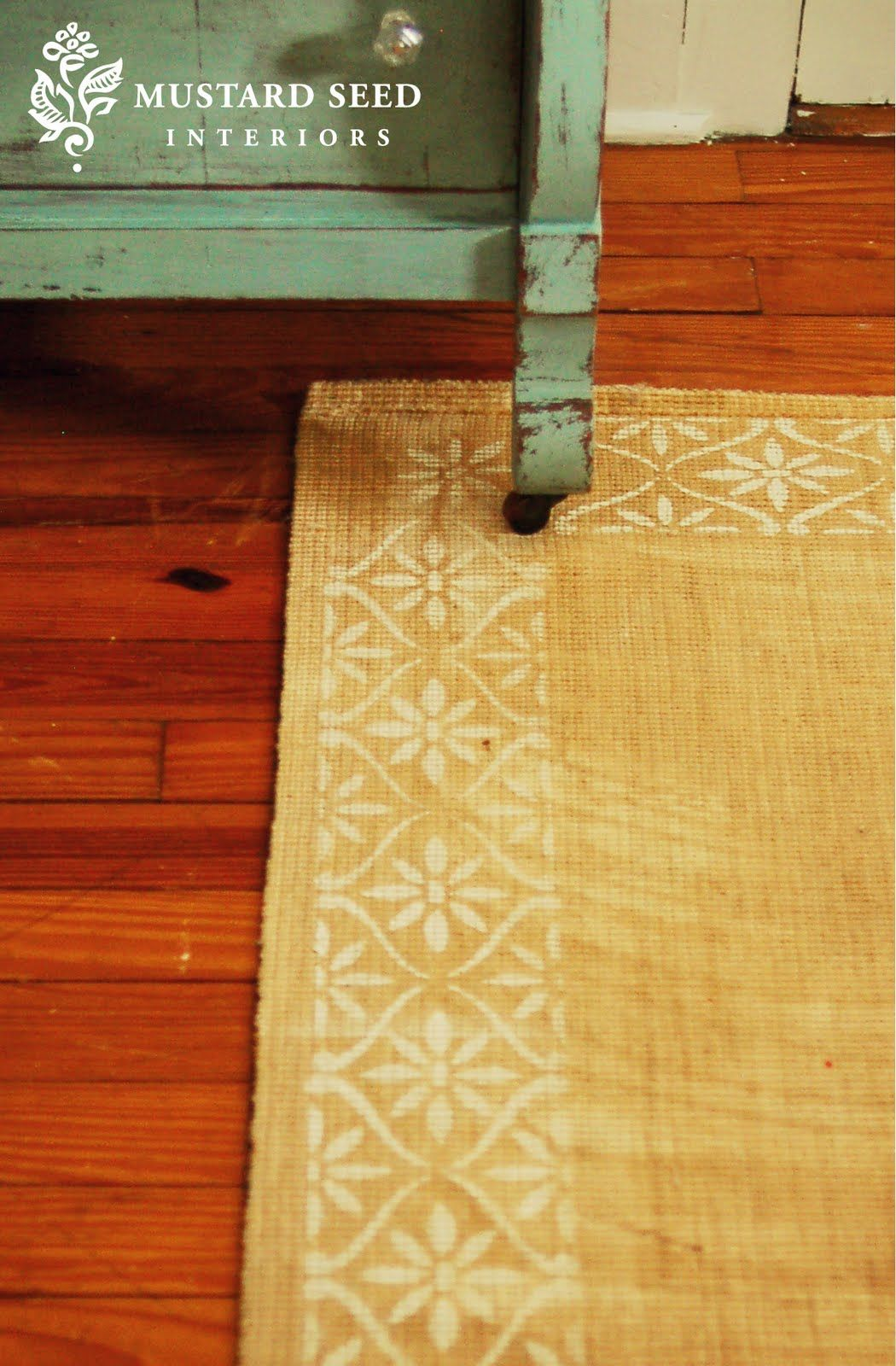 Jute rug with stenciled border - Turquoise chest with distressed ...