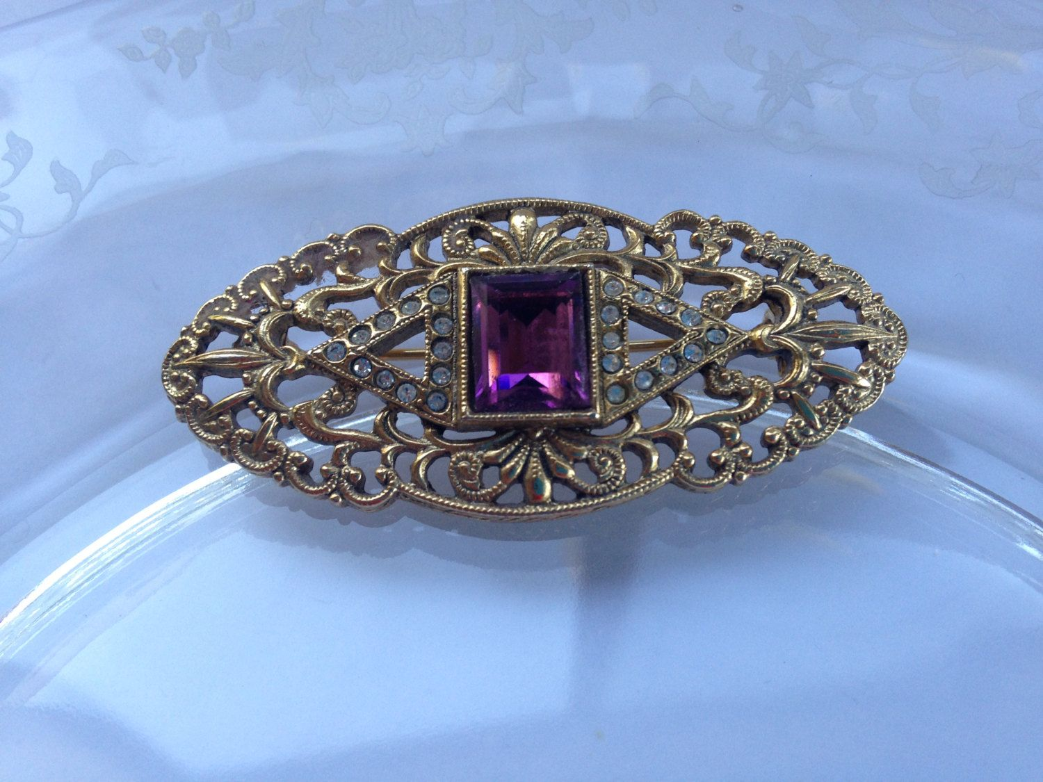 b203b5d35 Vintage Victorian Style Filigree Gold Tone Brooch Pin Emerald Cut Faux  Amethyst Glass Flanked by Tiny Clear Rhinestones by MyChocolatePuppy on Etsy