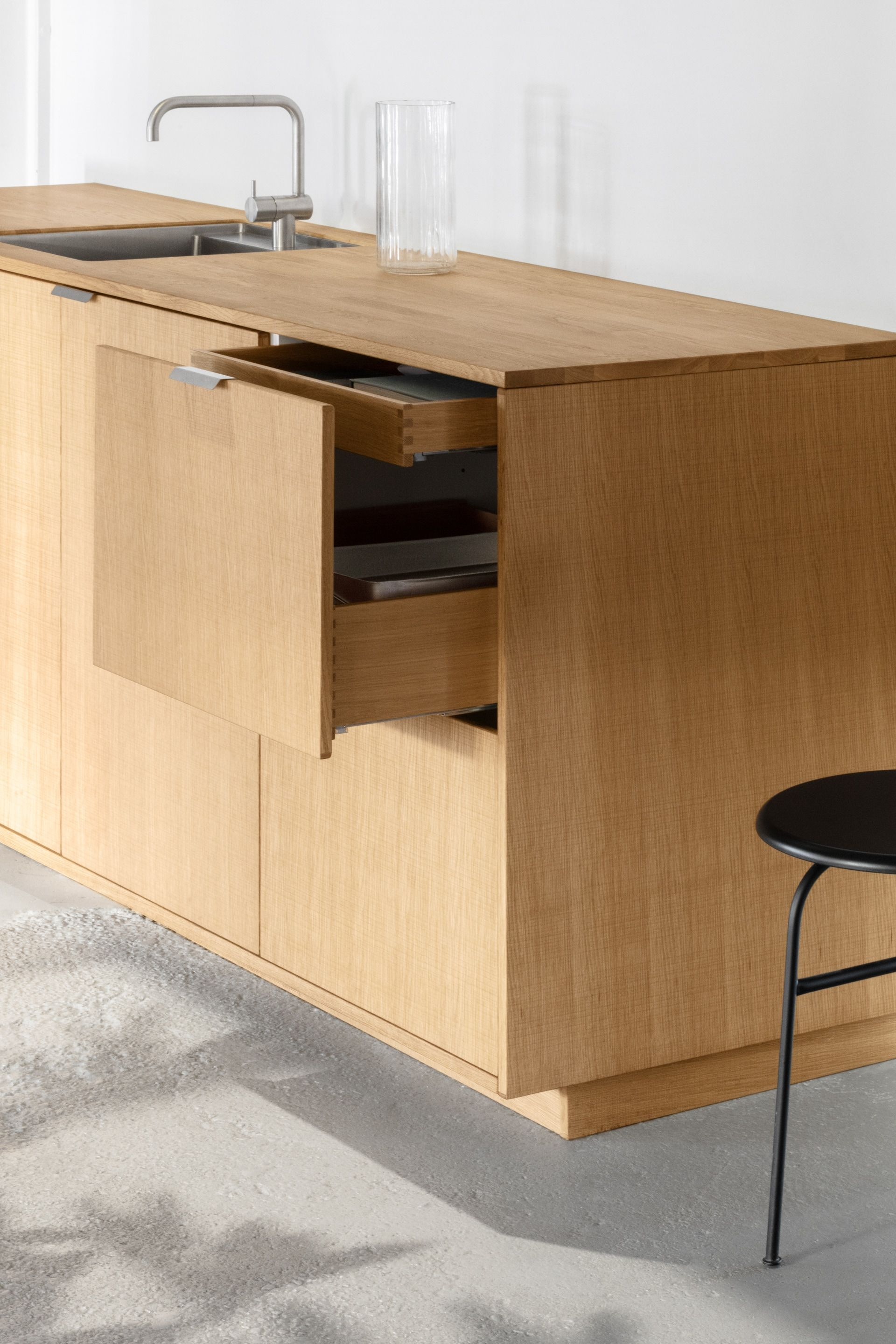 Reform's kitchen wood drawers in solid natural oak, smoked
