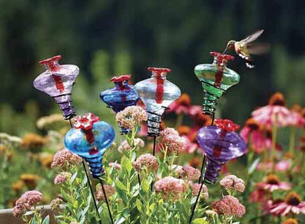 Here are cute hummingbird feeders that you stick in the