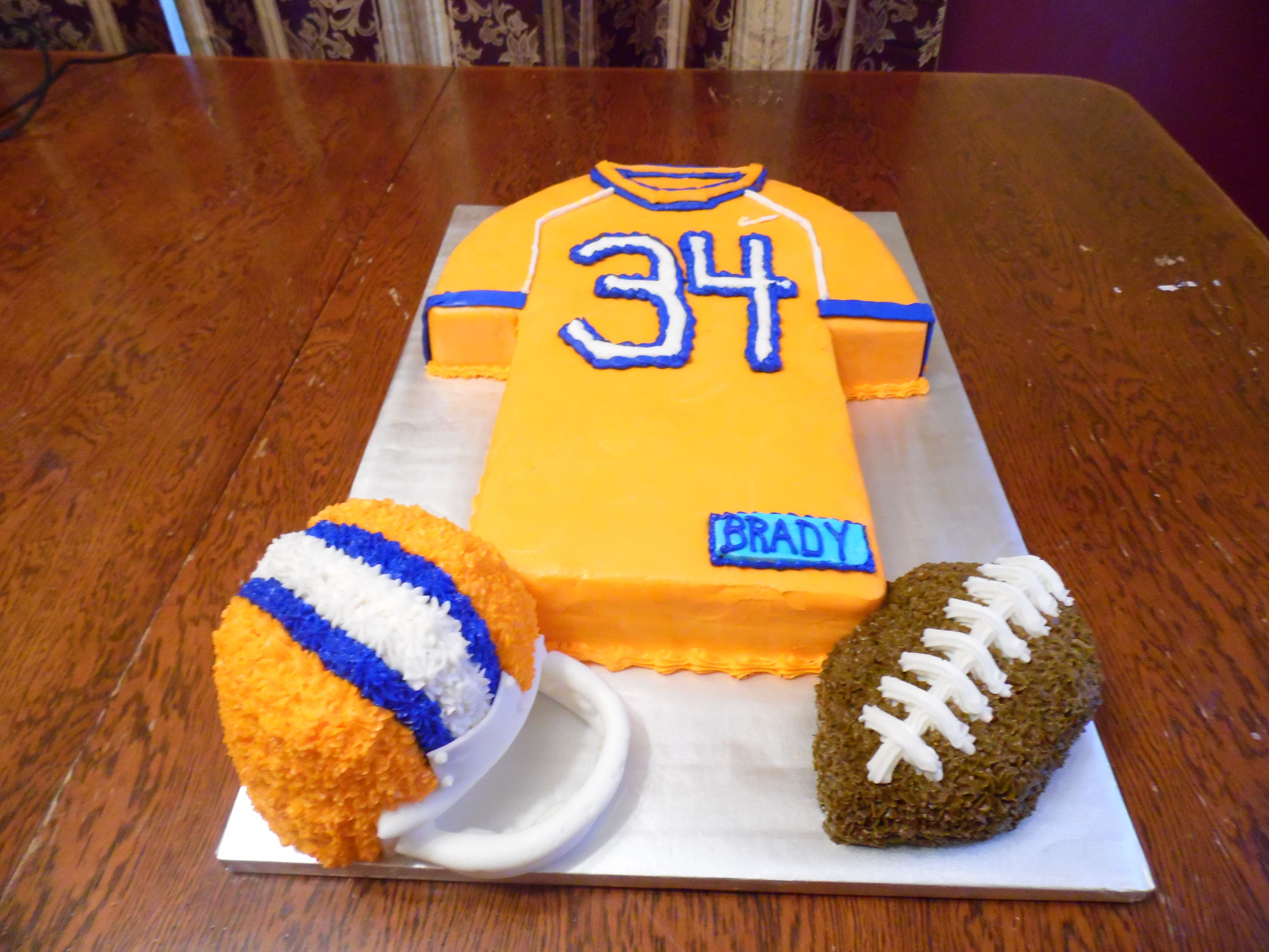 c505eb8d2 Jersey Football cake. I baked an 11x15 cake and cut it into the shape of a T -shirt. Wilton sales a T-shirt pan you can use. It will hold one cake  batter for ...