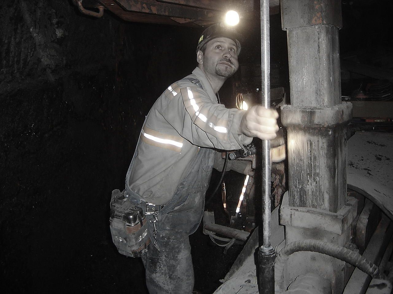 best images about coal mining virginia coke we mine coal an underground coal miner is installing steel bolts in the roof a