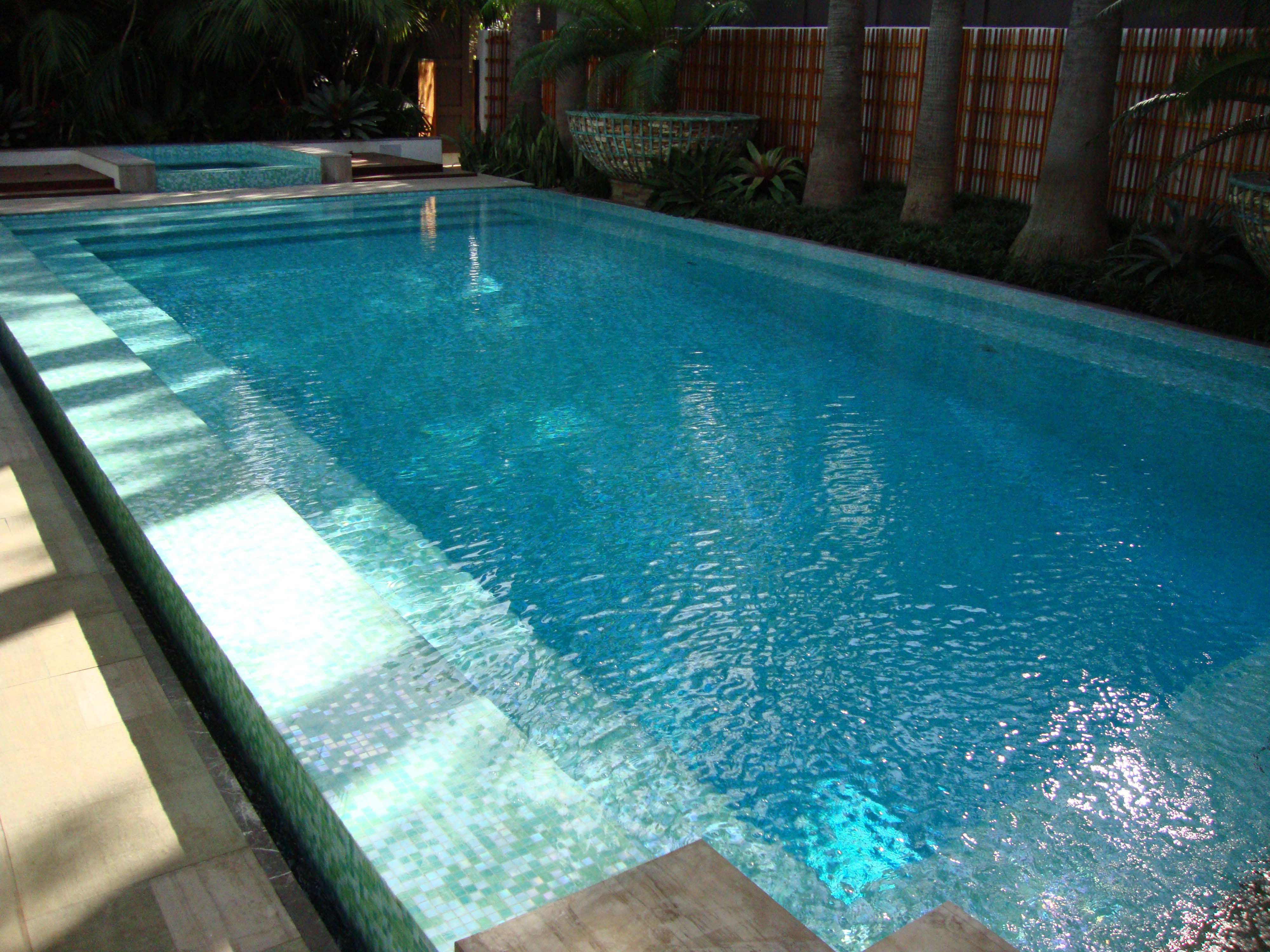 Jimmy reed built this incredible bisazza glass mosaic tile for Glass swimming pool