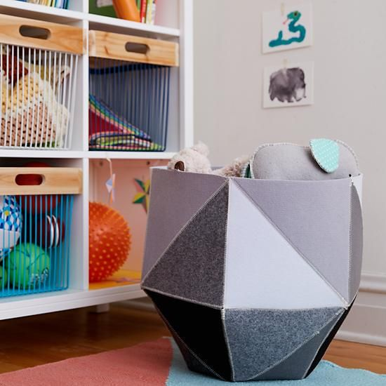Shop Geometric Floor Storage Bin.  Crafted from felt pieces and sewn into prism like configurations, no two sides of these felt geometric floor bins are the same.