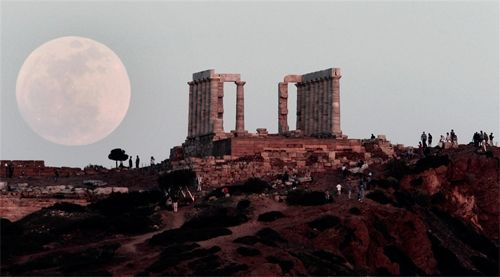 Supermoon over the Temple of Poseidon, Athens, Greece.