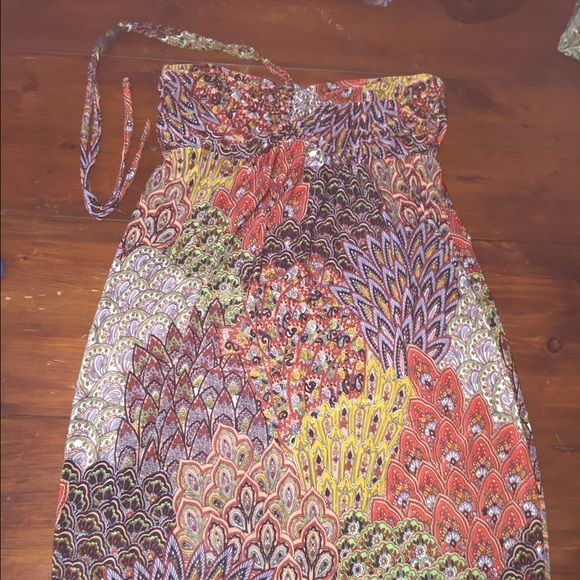 "Halter summer dress Beautiful thin material. Halter has beading on it. I wore twice as a swim suit cover. Comes to my knees and I'm 5'4.  26"" L and 14"" across bust. Bust is flexible on size due to the tube top elastic in back. Flowy and perfect for summer! Dresses"