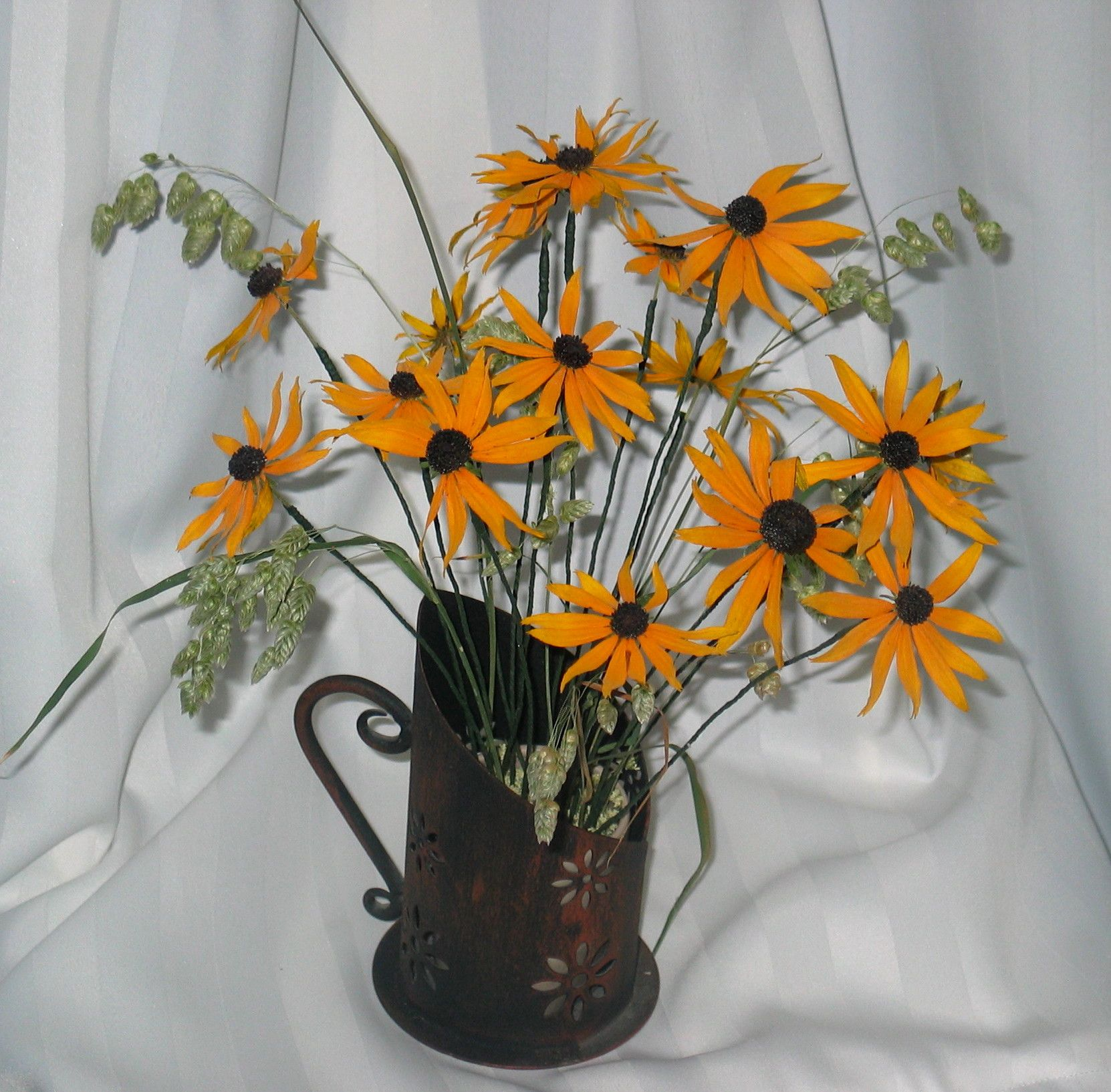 Blackeyed susans fill this old fashioned candle holders